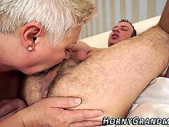Lusty granny sucks cock