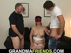 big hairy granny in lingerie swallows two cocks at once
