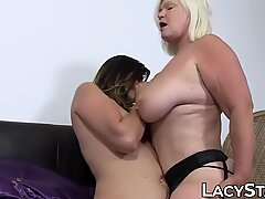 Busty blonde granny has lesbian sex with a young slut