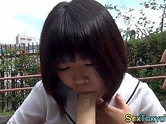 Japanese teen sucks dildo
